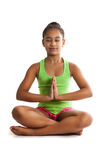 Girl doing is sitting with eyes closed in the lotus position Stock Images