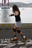 Girl doing skating in the city. Lisbon, Portugal Royalty Free Stock Images
