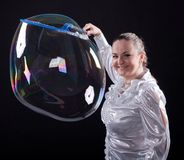 Girl is doing soap bubble show Stock Images