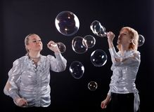 Girl is doing soap bubble show Royalty Free Stock Image