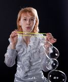 Girl is doing soap bubble show Royalty Free Stock Photo