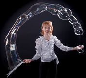 Girl is doing soap bubble show Royalty Free Stock Photography