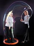 Girl is doing soap bubble show Stock Photos