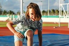 Girl doing sport. Closeup of girl practising high jump Stock Image
