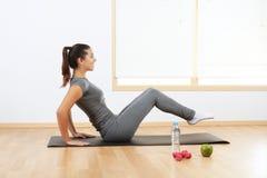 Girl doing sport exercises Stock Photos