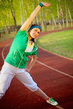 Girl doing sport exercises summer morning Royalty Free Stock Image