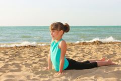 Girl doing sports exercises royalty free stock photography