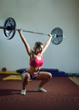 Girl doing squats with weight Stock Image