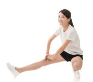 Girl doing stretch exercise Royalty Free Stock Image