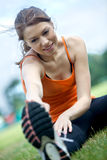 Girl doing stretching Royalty Free Stock Photography