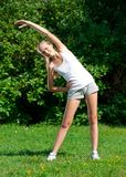 Girl doing stretching exercise Royalty Free Stock Images
