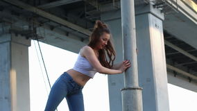 Girl doing stretching exercise outdoor. stock video