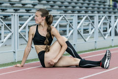 Girl doing stretching exercise Royalty Free Stock Image