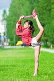 Girl doing stretching exercise. Yoga Stock Photo