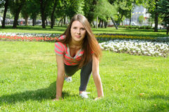 Girl doing stretching exercises for the feet outdoors Royalty Free Stock Photo