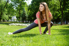 Girl doing stretching exercises for the feet outdoors Stock Image