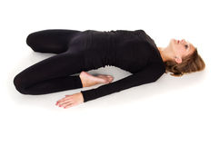 Girl doing stretching exercises lying Stock Photography