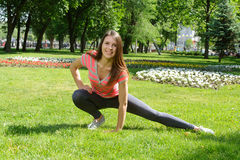 Girl doing stretching exercises outdoors Royalty Free Stock Image