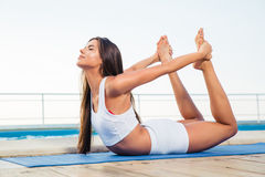 Girl doing stretching exercises outdoors Royalty Free Stock Photography