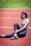 Girl doing stretching  exercises on track Stock Image