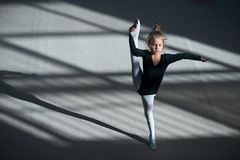 Girl doing stretching in gymnastics Royalty Free Stock Images