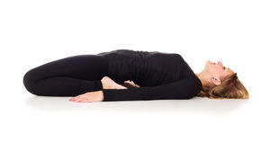 Girl doing stretching lying Royalty Free Stock Image