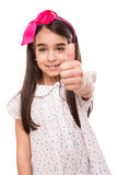 Girl doing thumbs up stock photo