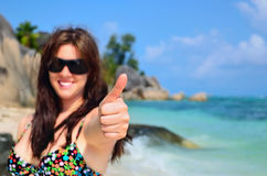 Girl doing the thumbs up sign Stock Image