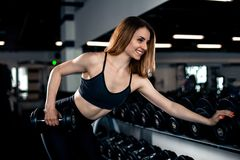 Girl doing triceps exercise with dumbbells stock photo