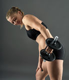 Girl doing triceps workout with dumbbells Stock Image