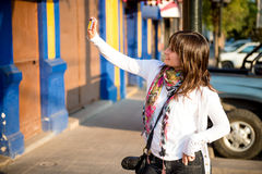 Girl doing an urban self portrait Stock Photo