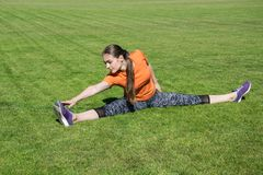Girl doing warm up before training royalty free stock photos