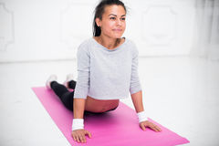 Girl doing warming up exercise for spine, backbend. Arching stretching her back working out at home or yoga class royalty free stock photos