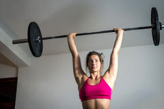 Girl doing weightlifting Stock Image