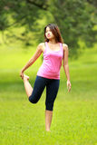 Girl doing workout on grass Royalty Free Stock Photos