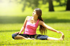 Girl doing workout on grass Royalty Free Stock Photo