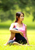 Girl doing workout on grass Royalty Free Stock Images