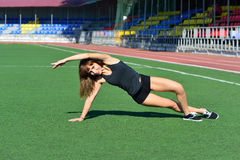 Girl doing a workout at the stadium Royalty Free Stock Photography