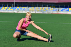 Girl doing a workout at the stadium Stock Photography
