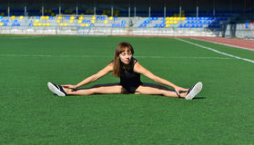 Girl doing a workout at the stadium Royalty Free Stock Images