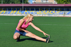 Girl doing a workout at the stadium Stock Photo
