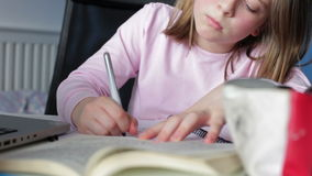 Girl Doing Written Homework In Bedroom stock video footage