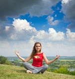 Girl doing yoga Royalty Free Stock Image