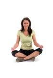 Girl doing yoga. Young girl practising yoga excersise Royalty Free Stock Photography