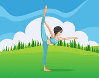 A girl doing yoga across the pine trees Stock Image