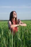Girl doing yoga against nature Stock Photos