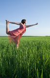 Girl doing yoga against nature  during sunset Stock Photos