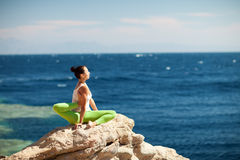 Girl doing yoga on the beach Royalty Free Stock Images