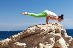 Girl doing yoga on the beach Royalty Free Stock Photo