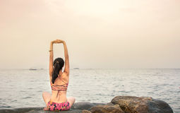 Girl doing yoga at the beach Royalty Free Stock Photo